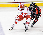 Jenelle Kohanchuk (BU - 19), Claire Santostefano (NU - 13) - The Northeastern University Huskies tied Boston University Terriers 3-3 in the 2011 Beanpot consolation game on Tuesday, February 15, 2011, at Conte Forum in Chestnut Hill, Massachusetts.