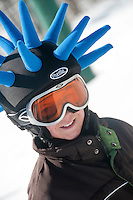 A young skier with a funny hat helmet at Indianhead Mountain ski resort near Wakefield Michigan.