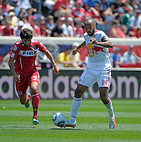 New York forward Thierry Henry (14) plays the ball in front of Chicago midfielder Baggio Husidic (9).  The Chicago Fire tied the New York Red Bulls 1-1 at Toyota Park in Bridgeview, IL on June 26, 2011.