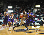 "Mississippi's Martavious Newby (1) is fouled by Lipscomb's J.C. Hampton (22) as Lipscomb's Deonte Alexander (4) also defends in the first half at the CM. ""Tad"" Smith Coliseum in Oxford, Miss. on Friday, November 23, 2012."