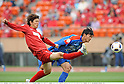 (R-L) Yuya Osako (Antlers), Xiong Fei (Shanghai), MAY 3rd, 2011 - Football : AFC Champions League Group H match between Kashima Antlers 2-0 Shanghai Shenhua at National Stadium in Tokyo, Japan. (Photo by Takamoto Tokuhara/AFLO).