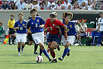 6 June 2004: Shannon MacMillan (red 8) tries to force her way between Tomomi Miyamoto (blue 8) and Hiromi Isozaki  (2) in the second half. The United States tied Japan 1-1 at Papa John's Cardinal Stadium in Louisville, KY in an international friendly soccer game..