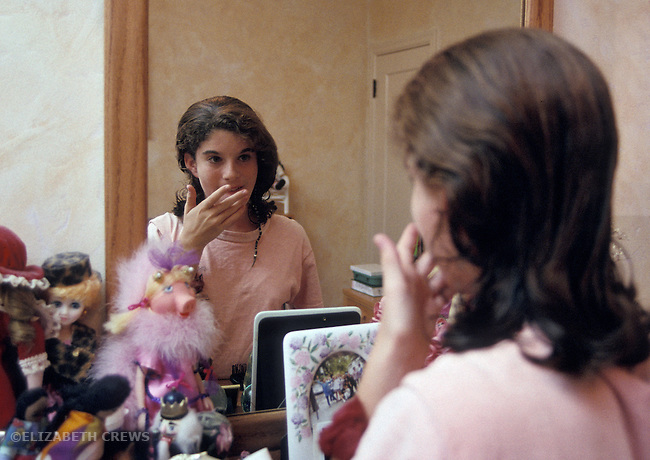 Berkeley CA Preteen girl, twelve-years-old starting to get obsessed with appearance, studying self in mirror  MR