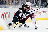 Jarret Stoll (Los Angeles Kings, #28) vs David Schlemko (Phoenix Coyotes, #6) during ice-hockey match between Los Angeles Kings and Phoenix Coyotes in NHL league, March 3, 2011 at Staples Center, Los Angeles, USA. (Photo By Matic Klansek Velej / Sportida.com)