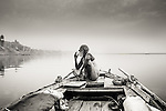 A boatsman, who calls himself Baba Boatsman, taking a cigarette break at sunrise (Varanasi, India).