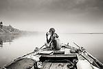 A boatsman, who calls himself Baba Boatsman, taking a cigarette break at sunrise (Varanasi, India).