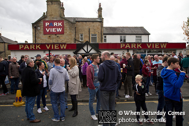 Burnley 1 West Ham United 3, 18/10/2014. Turf Moor, Premier League. Spectators drinking at the Park View bar outside The fixture was won by the visitors by three goals to one watched by 18,936 spectators. The defeat meant that Burnley still had not won a league match since being promoted from the Championship the previous season. Photo by Colin McPherson.