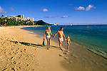 Hawaii: Oahu, Young family at Waikiki Beach, Honolulu, model released. Photo: hiorig105 .Photo copyright Lee Foster, www.fostertravel.com, 510/549-2202, lee@fostertravel.com
