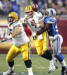 Green Bay Packers' Brett Favre is hit by Detroit Lions' Ernie Sims while he throws in the 2d quarter. .The Green Bay Packers traveled to Ford Field in Detroit Michigan to play the Detroit Lions on Thanksgiving Day, Thursday November 22, 2007. Steve Apps-State Journal.