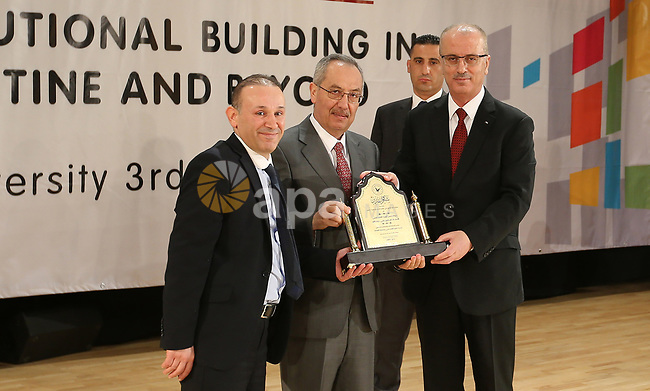 Palestinian Prime Minister Rami Hamdallah attends the conference of constitutional building in Palestine and beyond, at An-Najah national University in the West Bank city of Nablus on May 03, 2017. Photo by Prime Minister Office