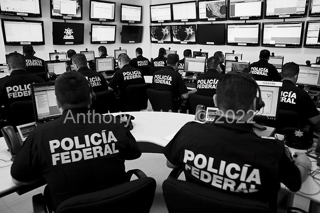 Mexico City, Mexico<br /> June 17, 2008<br /> <br /> Federal police monitor Mexico city and major cities throughout Mexico 24/7 with more then 34 monitors and officers communicating with field officers at the new federal police center. Some 30+ additional monitoring rooms throughout the country are planned to connect with this one for greater control of crime and drug traffic.