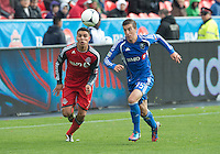 20 October 2012: Montreal Impact midfielder Jeb Brovsky #15 and Toronto FC midfielder Luis Silva #11 in action during an MLS game between the Montreal Impact and Toronto FC at BMO Field in Toronto, Ontario..The game ended in a 0-0 draw..