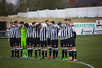 Chorley 2 Altrincham 0, 21/01/2017. Victory Park, National League North. The home players observing a minute's silence at Victory Park, before Chorley played Altrincham (in yellow) in a Vanarama National League North fixture. Chorley were founded in 1883 and moved into their present ground in 1920. The match was won by the home team by 2-0, watched by an above-average attendance of 1127. Photo by Colin McPherson.