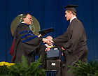 May 18, 2014; Former hockey player Anders Lee receives his bachelor degree from Mendoza College of Business Dean Roger Huang at the 2014 Commencement ceremony.  Lee plays for the NHL's New York Islanders.<br /> <br /> Photo by Matt Cashore/University of Notre Dame