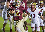 Florida State quarterback Deondre Francois scrambles in the first half of an NCAA college football game against Boston College in Tallahassee, Fla., Friday, Nov. 11, 2016.  Florida State defeated Boston College 45-7.