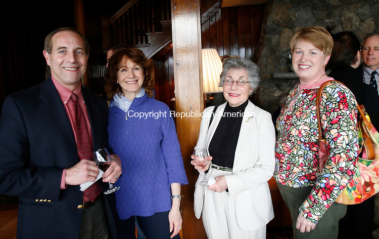 WARREN, CT, 04/30/09- 043009BZ32- From left- Peter and Nancy Schoenholtz, of Roxbury, Marilyn Lieff, of New Milford, and Jacqueline Fiori, of New Milford,  during a wine tasting benefit for the Housatonic Valley Association at the Boulders Inn on Lake Waramaug Thursday.<br />  Jamison C. Bazinet Republican-American
