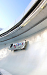 14 December 2006: Victoria Tokovaia, of Russia, pilots her sled through a turn during a training run in preparation for the World Cup Bobsleigh Competition at the Olympic Sports Complex on Mount Van Hoevenburg  in Lake Placid, New York, USA.&amp;#xA;&amp;#xA;Mandatory Photo credit: Ed Wolfstein Photo<br />