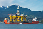 Environmental protesters in kayaks and inflatables are dwarfed by the 400 foot tall Polar Pioneer, an oil drilling platform brought in from Asia piggybacked on a large ship, on its way to Seattle and maybe Alaska. The protesters' boats and kayaks were ordered to keep 100 yards away from the platform, and that was enforced today by the Coast Guard.