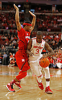 Ohio State Buckeyes guard Shannon Scott (3) drives past Nebraska Cornhuskers guard Deverell Biggs (1) in the first half at Value City Arena in Columbus Jan. 4, 2013 (Dispatch photo by Eric Albrecht)