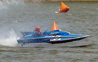 """The vintage Lauterbach built 225 inboard hydroplane """"Country Boy"""" drives through the slop of Madison's turn 2. This is the boat that former Miss Budweiser driver Jim Kropfeld (1982-1989) drove to a National Championship in 1975 thereby making a name for himself..Tom & Jac Bertolini, N-8 """"Country Boy"""", 1971 Lauterbach 225 class hydroplane..2004 Madison Regatta, Madison, Indiana, July 4, 2004"""