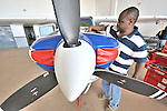 Rukang Chikomb is a United Methodist pilot who flies airplanes over the southern Congo as part of the Wings of the Morning aviation ministry of The United Methodist Church, which provides life-saving access to isolated rural communities. Here he works on the engine of one of the program's planes in a hangar in Lubumbashi.