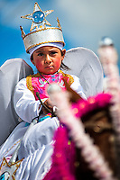 A child dancer (danzante) takes part in the religious parade within the Corpus Christi festival in Pujilí, Ecuador, 1 June 2013. Every year in June, thousands of people gather in a small town of Pujili, high in the Andes, to celebrate the Catholic feast of Corpus Christi. Introduced originally during the Spanish conquest of South America, this celebration merges Catholic rituals of Holy Communion with the traditional Andean harvest and sun festivities (Inti, the Inca sun god). Women dancers perform wearing brightly colored costumes while men dancers wear chest ornaments and heavy elaborate headdresses adorned with mirrors, jewelry, or natural items (shells). Being a dancer in the Corpus Christi ceremonial parade (El Danzante) is considered an honour and a privilege by the indigenous people in Ecuador.