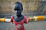A displaced girl waits to fill her water containers at a well in Agok, a town in the contested Abyei region where tens of thousands of people fled in 2011 after an attack by soldiers and militias from the northern Republic of Sudan on most parts of Abyei. Although the 2005 Comprehensive Peace Agreement called for residents of Abyei--which sits on the border between Sudan and South Sudan--to hold a referendum on whether they wanted to align with the north or the newly independent South Sudan, the government in Khartoum and northern-backed Misseriya nomads, excluded from voting as they only live part of the year in Abyei, blocked the vote and attacked the majority Dinka Ngok population. The African Union has proposed a new peace plan, including a referendum to be held in October 2013, but it has been rejected by the Misseriya and Khartoum.