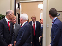 United States President Donald Trump walks into the Roosevelt Room to sign S. 544 the Veterans Choice Program Extension and Improvement Act in the Roosevelt Room at the White House in Washington, DC on April 19, 2017.<br /> CAP/MPI/CNP/RS<br /> &copy;RS/CNP/MPI/Capital Pictures