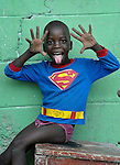 A boy in a Superman shirt in Batey Bombita, a community in the southwest of the Dominican Republic whose population is composed of Haitian immigrants and their descendents.