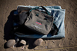 RENO, NV - OCTOBER 6:  A homeless person's belongings lie in the dirt of a tent city for the homeless in downtown Reno, Nevada October 6, 2008. The City of Reno set up the tent city when existing shelters became overcrowded as Nevada struggles with one of the highest unemployment rates in the country. (Photo by Max Whittaker/Getty Images)
