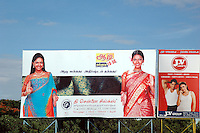 Billboards advertising garment companies in Tirupur, Tamilnadu. After lifting of quota system in textile export on 1st january 2005. Tirupur has become the biggest foreign currency earning town of India.