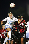UNC's Elizabeth Guess (30) outjumps NC State's Megan Buescher (20) to head the ball on Thursday, October 20th, 2005 at Fetzer Field in Chapel Hill, North Carolina. The University of North Carolina Tarheels defeated the North Carolina State University Wolfpack 1-0 during an NCAA Division I Women's Soccer game.
