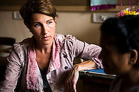 Tamsin Greig, an actress from the United Kingdom, speaks with Jasmine (name changed), aged 30, about her past experiences as they sit in Nirmal Bhavan, a rehabilitation home for trafficked and rescued girls run by Tearfund partner NGO Oasis India, in Mumbai, Maharashtra, India on 20 February 2014. Jasmine was ten when she was sold for 50,000 Indian Rupees by her family friends who were supposed to look after her. She was beaten, drugged and forced in to prostitution. Rescued from a brothel age 16, she came to live at Nirmal Bhavan and now works for Oasis. Photo by Suzanne Lee/Tearfund