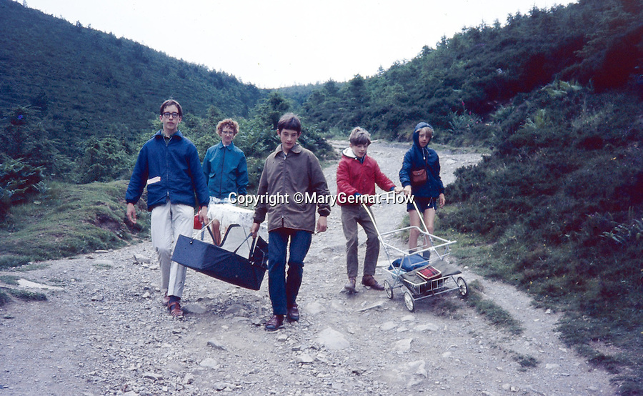 BNPS.co.uk (01202 558833)<br /> Pic: MaryGernat-How/BNPS<br /> <br /> ***Single Use - Not For Archive***<br /> <br /> Mary and boys on holiday in the late sixties.<br /> <br /> The real family behind Enid Blyton's iconic book covers has been revealed for the first time thanks to a hidden archive of sketches and family photos.<br /> <br /> Mary Gernat, who created the paperback covers for about 100 children's books in the 1960s, would get her young sons to stop mid-play and pose for her while she quickly sketched ideas for books like The Famous Five, the Secret Series, St Clare's and Malory Towers.<br /> <br /> Her son Roger How, 58, has now unveiled some of his mother's never-seen-before original sketches and finished book drafts which capture the classic images of childhood adventure he and his brothers helped create.
