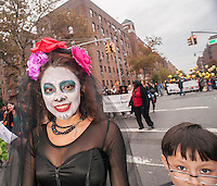 Families celebrate Halloween in the 24th Annual Jackson Heights Halloween Parade in Jackson Heights in the Queens borough of New York on Thursday, October 31, 2013. Over three thousand neighborhood residents marched down 37th Ave., a main shopping street, with the children receiving treats at the end of the parade courtesy of the Jackson Heights Beautification Committee. (© Richard B. Levine)