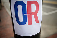 A poster that says &quot;OR / Obama Romney / Believe in Healthcare Ticket&quot; hangs on a post in downtown Manchester, New Hampshire, on Jan. 7, 2012.  Romney is seeking the 2012 Republican presidential nomination. Romney oversaw the creation of a mandatory health insurance program in Massachusetts that critics liken to Obama's healthcare plans, so called &quot;Obamacare.&quot;  Some call Romney's plan &quot;Obamneycare.&quot;