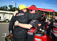 Aug 21, 2016; Brainerd, MN, USA; NHRA pro stock driver Drew Skillman celebrates with crew members after winning the Lucas Oil Nationals at Brainerd International Raceway. Mandatory Credit: Mark J. Rebilas-USA TODAY Sports
