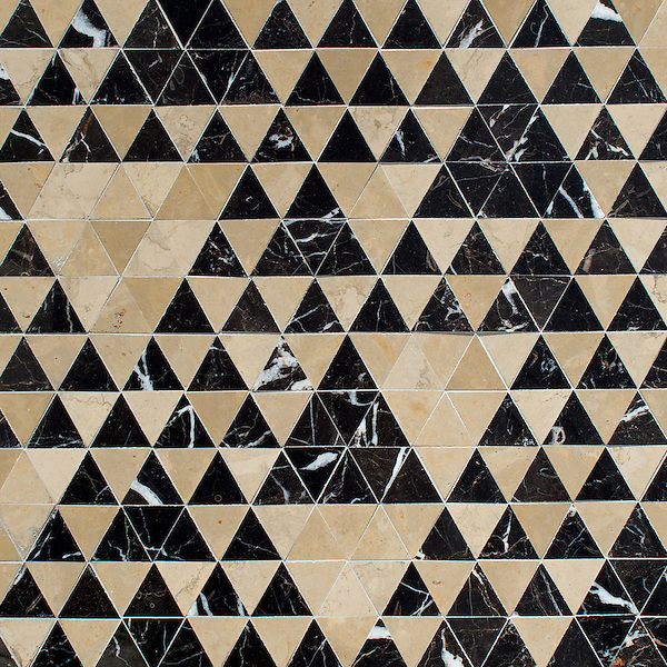 Cyril, a hand-cut stone mosaic, shown in polished Saint Laurent and honed Lagos Gold, is part of the Palazzo collection by New Ravenna.
