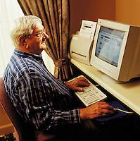 Older man at computer.