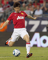 Manchester United FC midfielder Ji-Sung Park (13) dribbles before he scores. In a Herbalife World Football Challenge 2011 friendly match, Manchester United FC defeated the New England Revolution, 4-1, at Gillette Stadium on July 13, 2011.