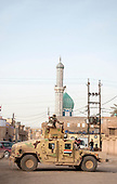 KIRKUK, IRAQ:  An Iraqi Army humvee on the streets of Kirkuk...Security is tightened in the volatile Iraqi city of Kirkuk the day before the national elections.  Kirkuk is home to Kurds, Arabs, and Turkmen and has been so violently divided that the city could not participate in the 2005 elections.
