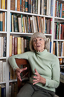 Book editor and author Judith Jones poses in front of her collection of cooking books in her apartment in New York City, USA, 2 October 2009.