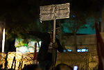 "An Egyptian protester carries a sign that reads ""Hey Mubarak, Game Over"" outside the presidential palace as he and a crowd of thousands celebrate news that Egyptian President Hosni Mubarak had stepped down February 11, 2011 following momentous marches on the public buildings across Cairo, Egypt. (Photo by Scott Nelson)"