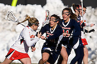 Grace Gaeng (5) of Maryland tries to make her way past Ryan Ball (10) and Mary Flowers (11) of Richmond at the practice turf field in College Park, Maryland.  Maryland defeated Richmond, 17-7.
