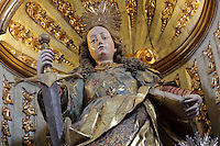 Statue of St Catherine of Alexandria (patron saint of philosophers), by Fray Cipriano da Cruz, 1725-30, in the Sao Miguel Chapel, or St Michael's Chapel, designed in Manueline style 1517-22 by Marco Pires and completed by Diogo de Castilho, on the site of a 12th century chapel in the University of Coimbra, Coimbra, Portugal. In the chancel is the Mannerist altarpiece, designed by Bernardo Coelho in 1605 and made by sculptor Simon Mota, with paintings by Simon Rodrigues and Domingos Vieira Serrao. The chapel was renovated in the 17th and 18th centuries, with Manuel Ramos making the pulpit in 1684, ceiling painted by Francisco F de Araujo, tiled floor added 1613, Baroque organ with 2,000 pipes built 1733 by Fray Manuel de Sao Bento, and Gabriel Ferreira da Cunha painting chinoiserie elements in 1737. The University of Coimbra was first founded in 1290 and moved to Coimbra in 1308 and to the royal palace in 1537. The building is listed as a historic monument and a UNESCO World Heritage Site. Picture by Manuel Cohen