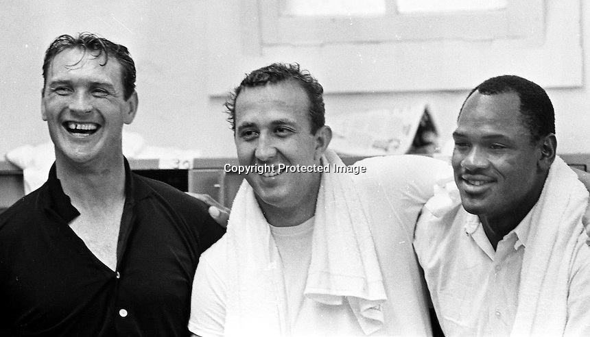 Raiders in the locker room after win, Billly Cannon, Tom Flores and Hewritt Dixon, 1966 photo by Ron Riesterer