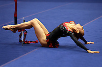 Daria Krajisnik of USA, finishing pose with ribbon at San Francisco Invitational on February 11, 2006. (Photo by Tom Theobald.