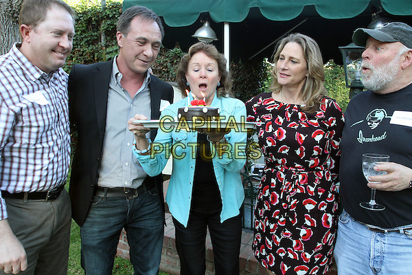 Nancy Stephens, Betsy Butler, Eric Rosenthal.Leaders from across the 50th District support of Betsy Butler's re-election Campaign Held At A Private Residence, Brentwood, California, USA, .3rd March 2012.half length blue turquoise shirt birthday cake blowing out candles .CAP/ADM/FS.©Faye Sadou/AdMedia/Capital Pictures.