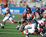 Jacksonville State quarterback Marques Ivory (12) is sacked by Ole Miss linebacker D.T. Shackelford (42) at Vaught-Hemingway Stadium in Oxford, Miss. on Saturday, September 4, 2010.