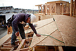 Nick Huizar works on a new home being built in a Folsom, California development, March 15, 2013.